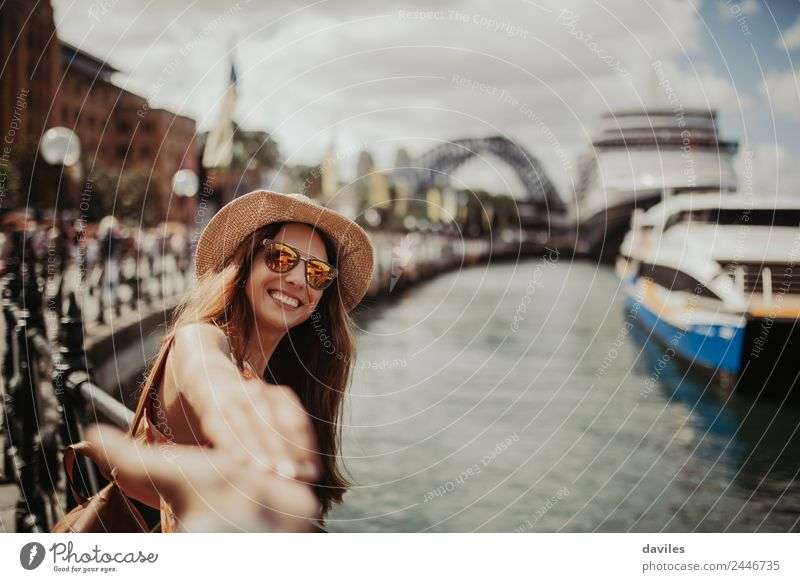 Cute woman in hat and sunglasses holding her boyfriend hand in Sydney city, Australia. Lifestyle Joy Vacation & Travel Trip Adventure City trip Human being