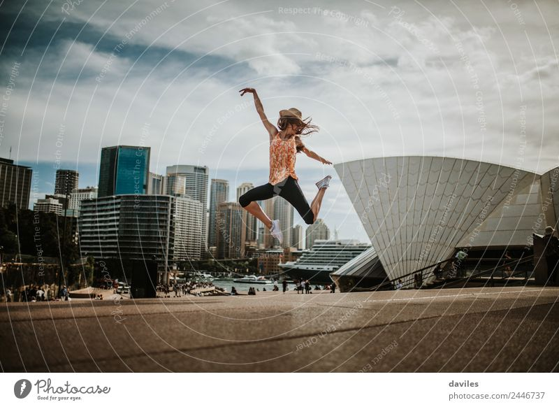 Cute woman jumping with Opera House in the background Lifestyle Joy Leisure and hobbies Vacation & Travel Tourism Trip Human being Young woman