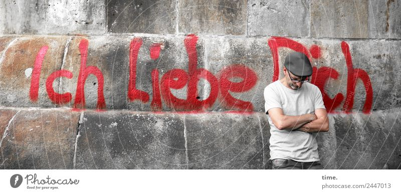 UT Dresden. We love you too. Masculine Man Adults 1 Human being Wall (barrier) Wall (building) T-shirt Eyeglasses Cap Characters Graffiti To hold on Stand Wait