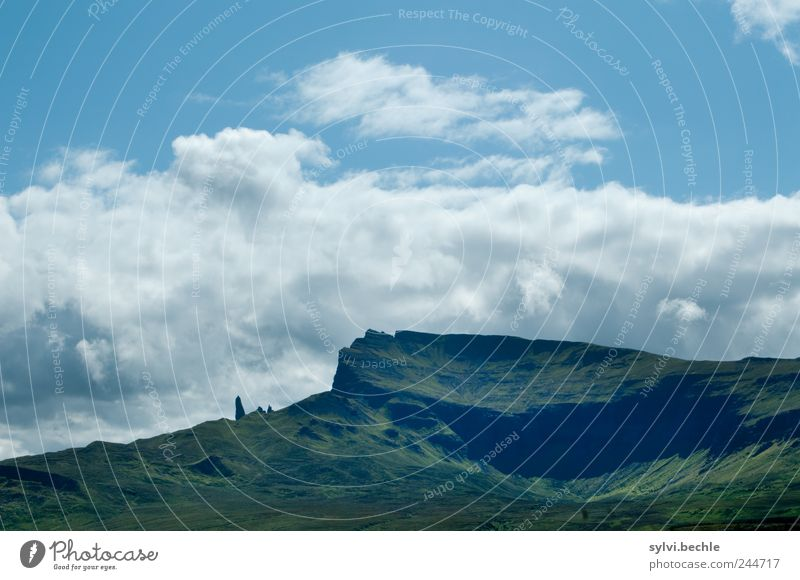 Scotland II Nature Landscape Sky Clouds Summer Climate Hill Rock Mountain Blue Green Environment Towering Volcanic crater Bank of clouds Europe Old Man of Storr