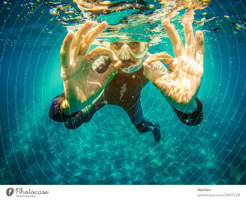 "Underwater diver doing ""ok"" sign to the camera Lifestyle Joy Leisure and hobbies Vacation & Travel Summer Ocean Sports Dive Human being Man Adults Hand 1"