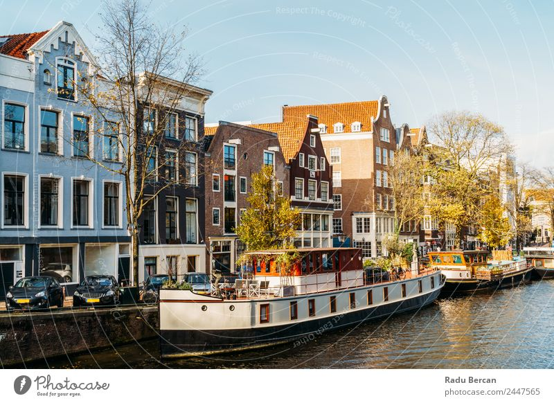 Architecture Of Dutch Houses and Houseboats On Amsterdam Canal Sky Vacation & Travel Town Colour Beautiful Water Landscape House (Residential Structure) Street