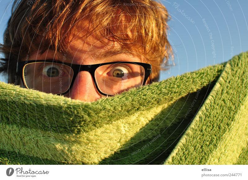 covert investigations Masculine Young man Youth (Young adults) Eyes Eyeglasses Observe Looking Blonde Blue Green Curiosity Spy Towel Stripe Surprise Concealed