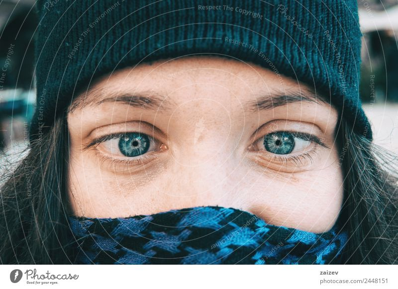 Blue-eyed girl in a winter hat playing dumb with her eyes Woman Human being Nature Youth (Young adults) Young woman Christmas & Advent Colour Beautiful White
