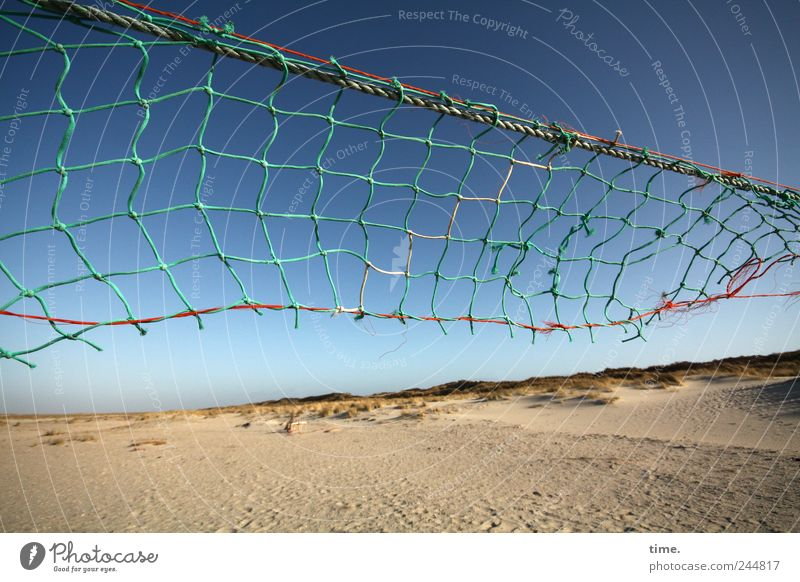 Spiekeroogpochtplatz. Beach Sand Sky Signs and labeling String Net Old Tall Broken Volleyball net Torn Defective Diagonal Volleyball court Gust of wind Shabby