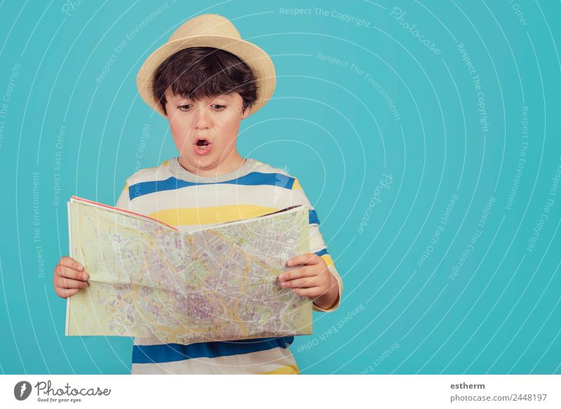 boy with hat and map Lifestyle Vacation & Travel Tourism Trip Adventure Sightseeing City trip Summer vacation Human being Masculine Child Toddler Infancy 1