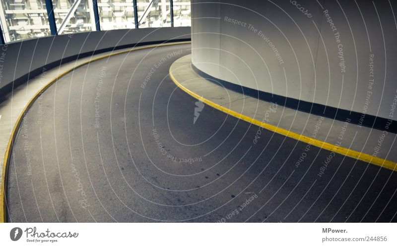 curve Parking garage Building Architecture Transport Traffic infrastructure Street Tunnel Gloomy Yellow Gray Curve Curbside Curved Expressway exit Asphalt