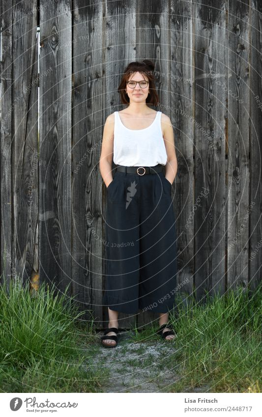 STANDING IN FRONT OF A WOODEN WALL - WOMAN - SELF-CONFIDENT pretty Feminine Young woman Youth (Young adults) 1 Human being 18 - 30 years Adults Fashion