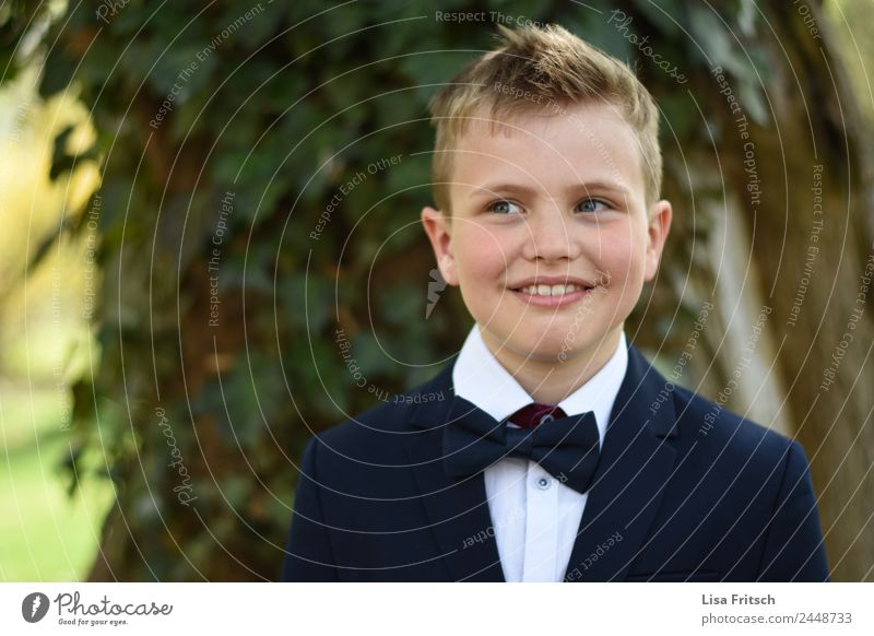boy in suit, with bow tie, smile Feasts & Celebrations Communion Masculine Boy (child) 1 Human being 8 - 13 years Child Infancy Fashion Bow tie Blonde Part