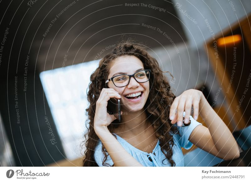 Pretty young woman laughs during a telephone call Lifestyle Joy Happy Well-being Contentment Living or residing Flat (apartment) University & College student
