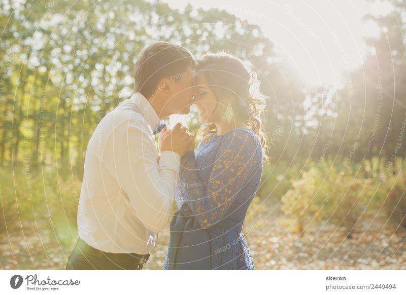 loving couple shows feelings in the setting sun Harmonious Summer Feasts & Celebrations Valentine's Day Wedding Human being Masculine Feminine Young woman