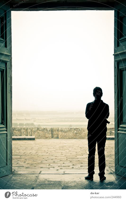 shelter Human being Masculine Man Adults 1 Landscape Horizon Weather Bad weather Storm Wind Gale Fog Rain Church Dome Looking Stand Wait Break Colour photo