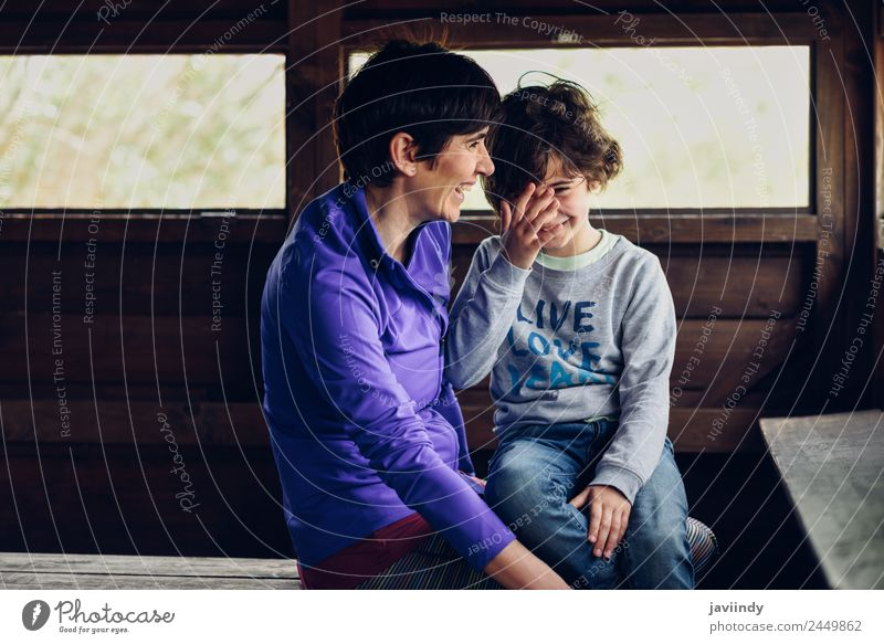 Mother with her seven year old daughter laughing Joy Child Human being Girl Woman Adults Family & Relations Infancy 2 3 - 8 years 45 - 60 years Wood Smiling