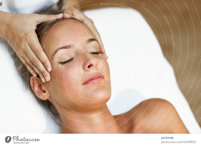 Young blond woman receiving a head massage i Lifestyle Happy Beautiful Skin Face Health care Medical treatment Wellness Relaxation Spa Massage Human being