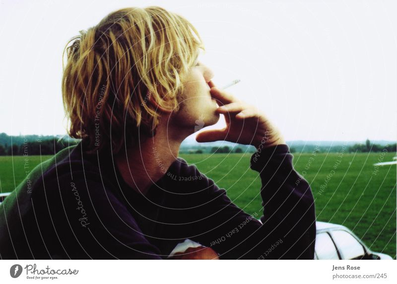 t.01 Meadow Summer Man Human being Smoking Relaxation Young man Youth (Young adults) 18 - 30 years Smoky Cigarette Break Blonde Profile Easygoing To enjoy