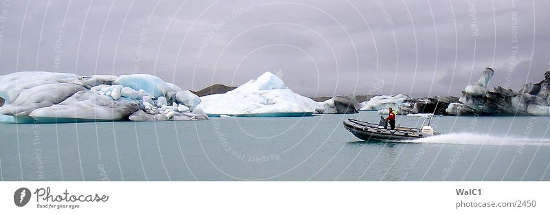 Glacial lake 01 Iceberg Mountain lake Vatnajökull glacier Watercraft Iceland Environmental protection National Park Untouched Europe Nature Power