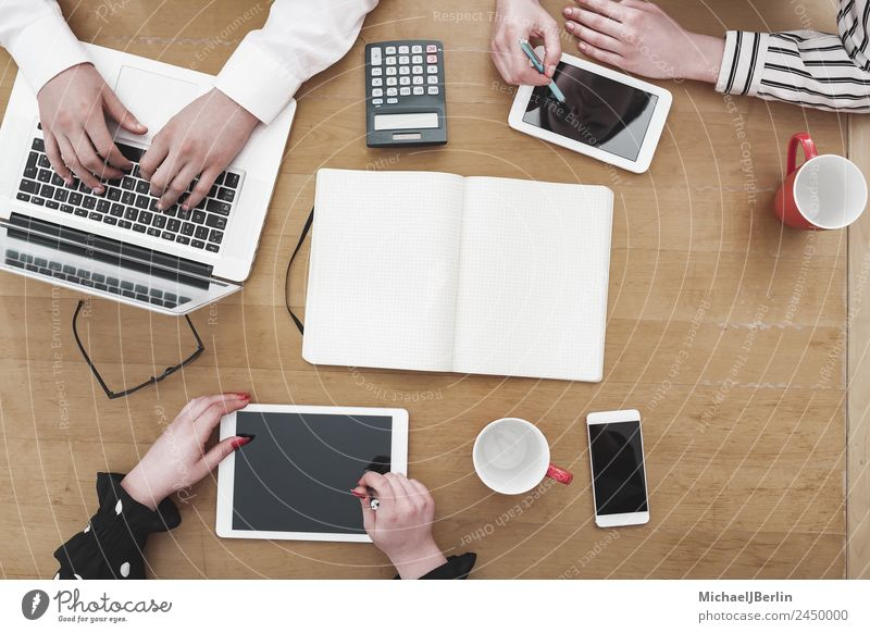 Young startup employees work at their desks Cup Profession Workplace Office Business Career Team Cellphone Notebook Human being Masculine Feminine 3