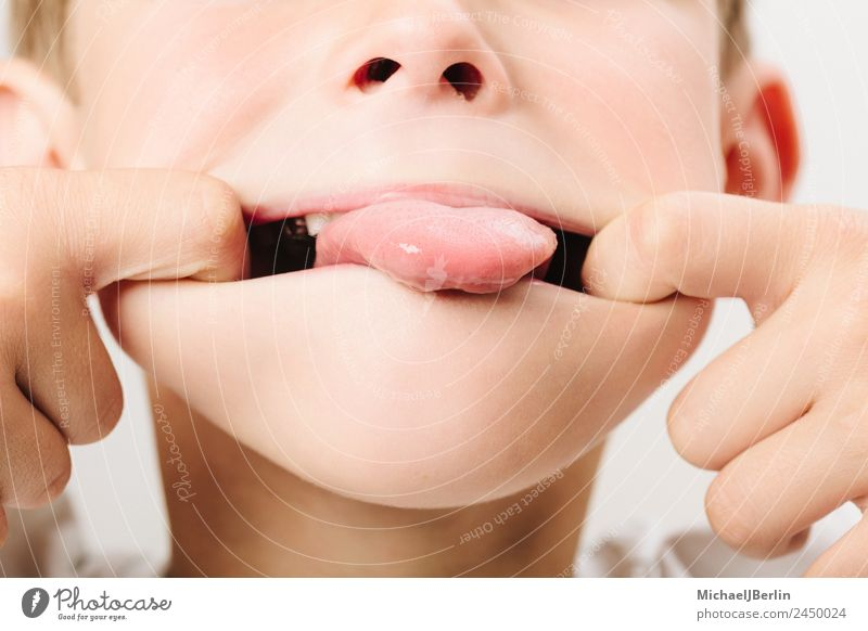 Boy of primary school age fooling around Joy Playing Masculine Child Boy (child) Infancy 1 Human being 3 - 8 years Funny Toddler Tongue Colour photo Close-up