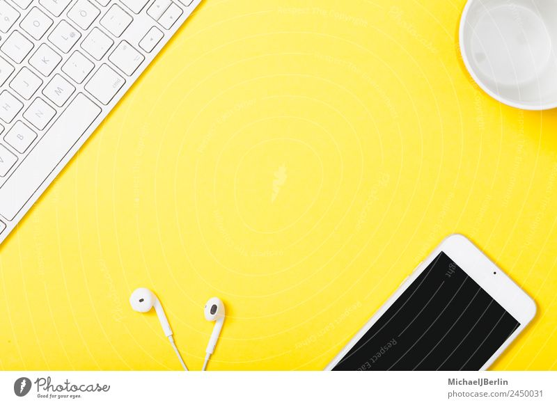 Mobile phone and headphones on yellow background Cup Office Cellphone Keyboard Happiness Yellow Background picture Clever Symbols and metaphors Headphones