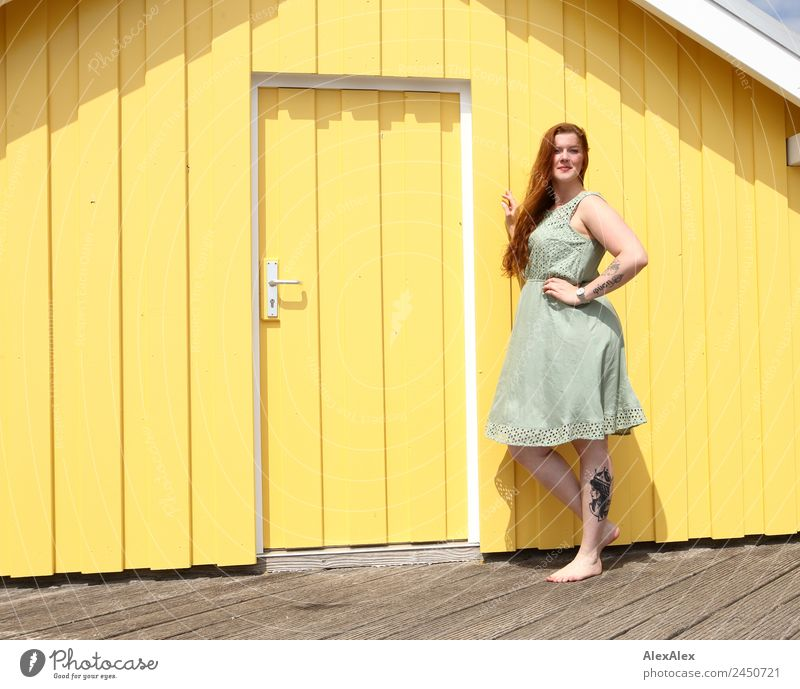 Woman in front of a yellow beach house Lifestyle Style Beautiful Harmonious Well-being Wooden house Young woman Youth (Young adults) Adults 18 - 30 years Summer