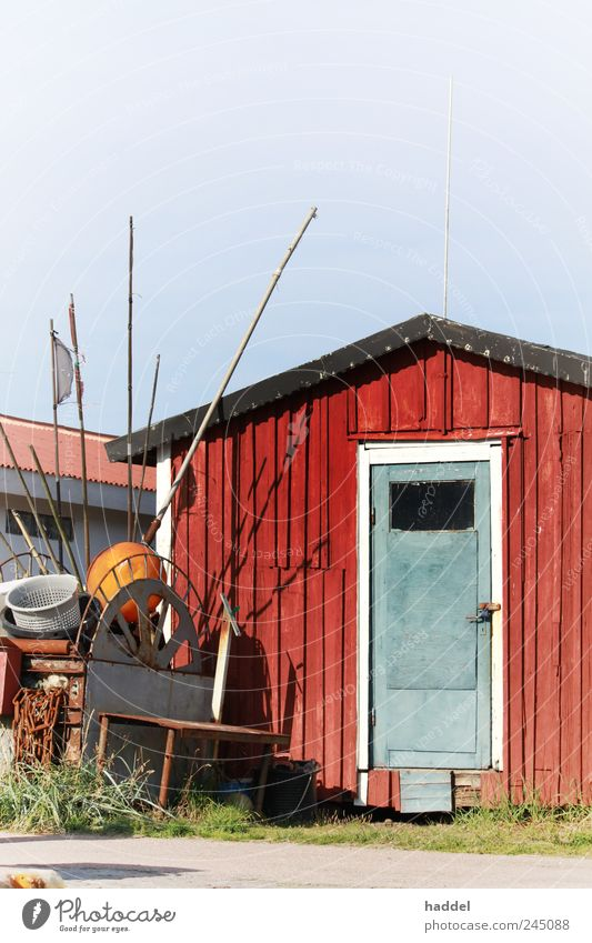 fisherman's hut Tourism Hut Coast Baltic Sea Sweden Fishing village Harbour Door Blue Red Maritime Wooden board Roof Flag Fishery Fishing net Storage Industry