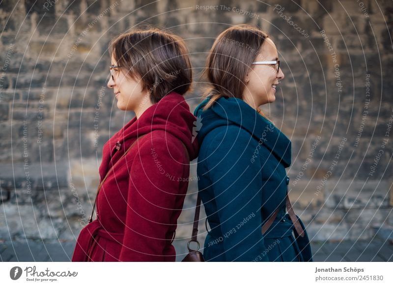 Twin sisters stand back to back Lifestyle Style Joy luck Human being Feminine Young woman Youth (Young adults) Brothers and sisters Sister 2 Happiness