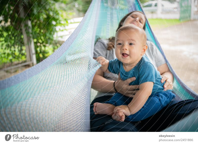 The little boy and mother are sitting at the hammock Woman Child Human being Beautiful Joy Adults Lifestyle Love Family & Relations Happy Small Playing Infancy