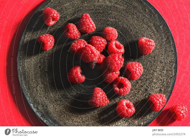 Fresh raspberries on rustic black plate Raspberry Plate Grunge Fruit Black Mature Healthy Eating Natural Organic Berries Red Nutrition Diet Ingredients Raw