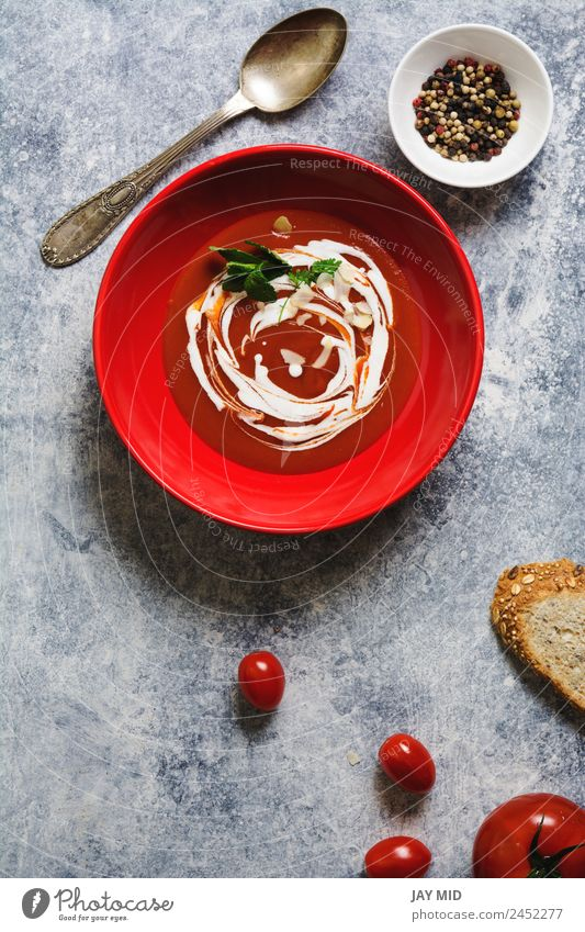 tomato cream soup in red bowl on grunge background Soup Tomato Cream Dish Red Healthy Eating Vegetarian diet Meal Pepper Herbs and spices Parsley oil olive