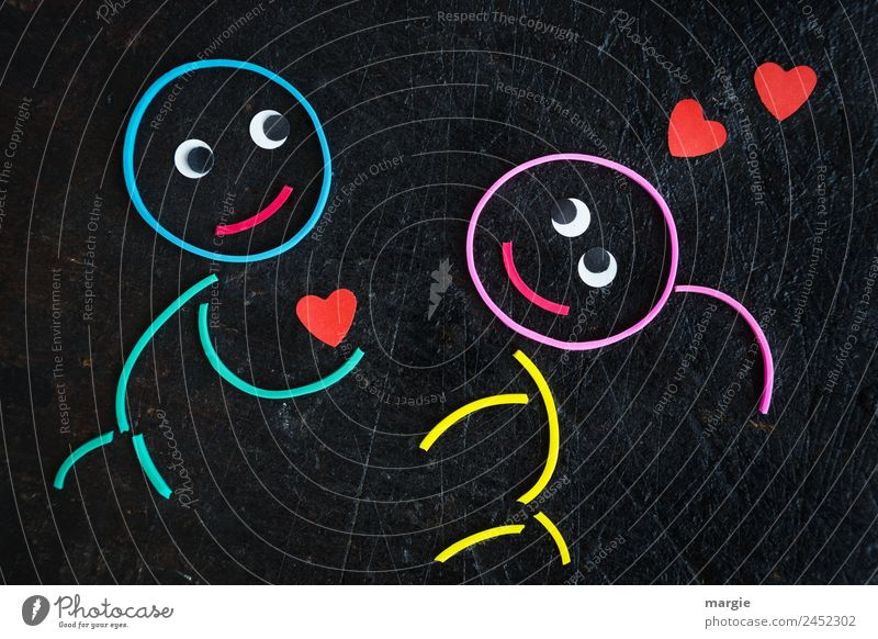 Rubber worms: declaration of love Masculine Feminine Girl Boy (child) Eyes 2 Human being Multicoloured Red Black Emotions Anticipation Trust Agreed Friendship