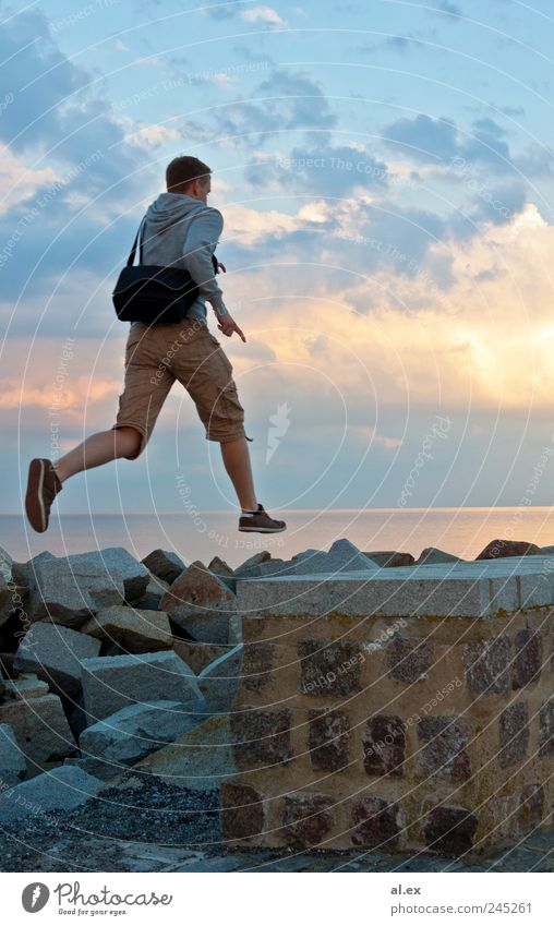 Human being Water Wall (building) Jump Stone Wall (barrier) Adults Rock Concrete Masculine Infinity Joie de vivre (Vitality) Athletic Baltic Sea Beautiful weather Enthusiasm