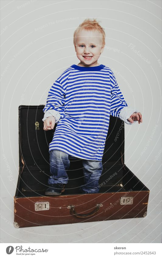 smiling boy in a long t-shirt in a suitcase Human being Baby Boy (child) Infancy Skin Head Hair and hairstyles Face Eyes Ear Nose Mouth 1 1 - 3 years Toddler