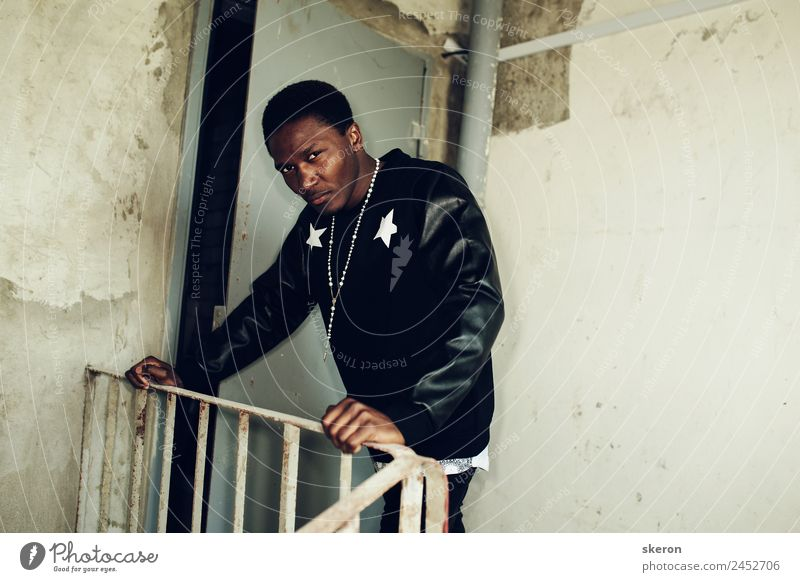 harsh African guy in a stylish jacket Lifestyle Elegant Style Hooligan Human being Masculine Young man Youth (Young adults) Adults Hair and hairstyles Eyes 1