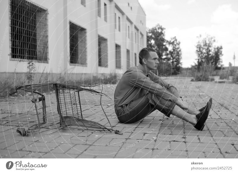 young man sitting near the basket Human being Vacation & Travel Youth (Young adults) Town Young man Calm Window 18 - 30 years Face Lifestyle Adults