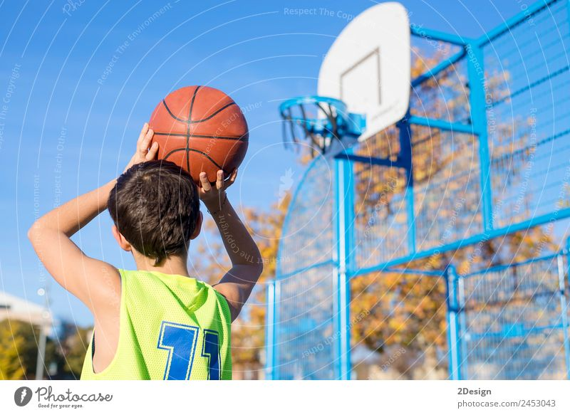 Young teenager male playing basketball on an outdoors court. Lifestyle Joy Athletic Relaxation Leisure and hobbies Playing Sports Human being Masculine