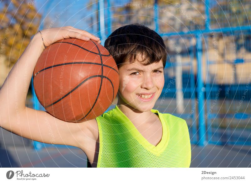 Young basketball player standing on the cour Lifestyle Joy Relaxation Leisure and hobbies Playing Sports Ball Human being Masculine Boy (child) Young man