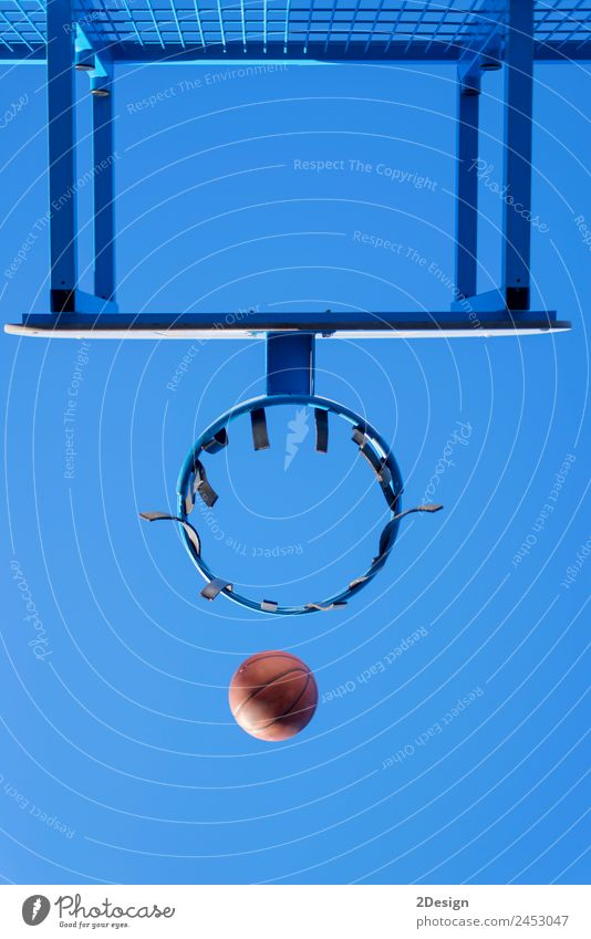image of a ball beside a basketball hoop Relaxation Playing Wallpaper Rope Sky Clouds Blue Black White Competition Action Court building Fast Goal Horizontal