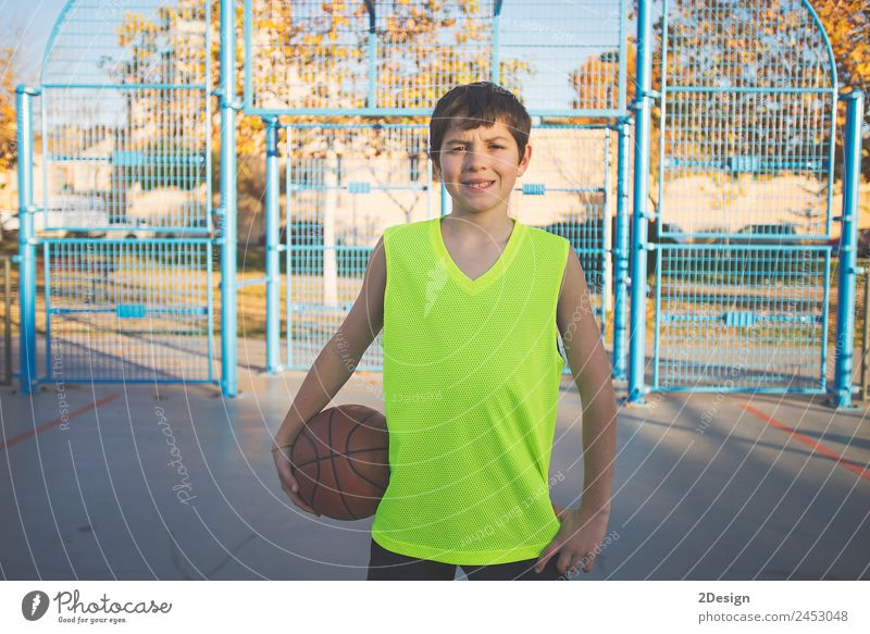 Teenage boy holding a basketball on a court Lifestyle Relaxation Playing Sports Ball Telephone PDA Human being Masculine Boy (child) Young man
