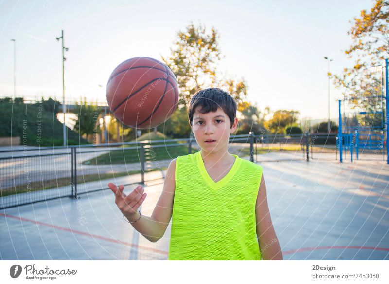 Beautiful young teen model wearing a yellow sleeveless and holding the ball on the court Lifestyle Happy Face Relaxation Leisure and hobbies Playing Sports