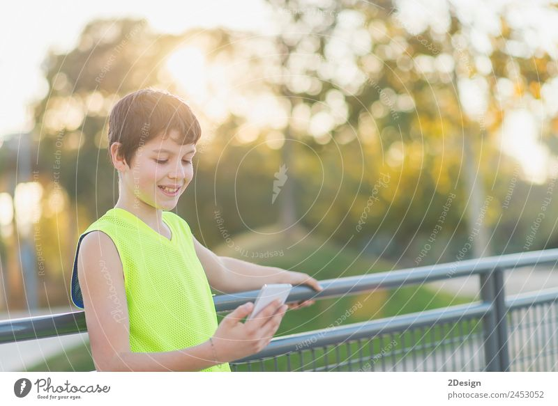 teenager smiling looking his smartphone on a basketball court Lifestyle Style Joy Happy Leisure and hobbies Decoration School Academic studies Telephone