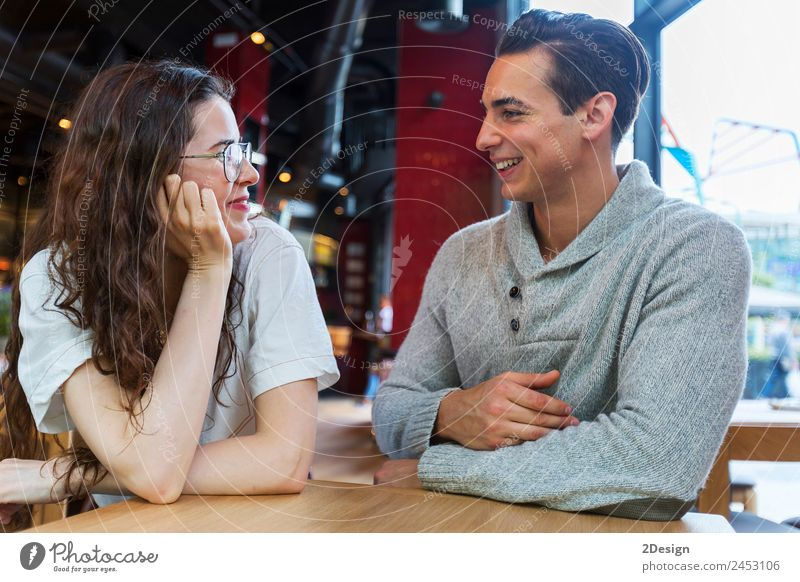 Side view of loving couple looking at each other Lunch Coffee Lifestyle Happy Beautiful Leisure and hobbies Table Restaurant Flirt To talk Human being Masculine