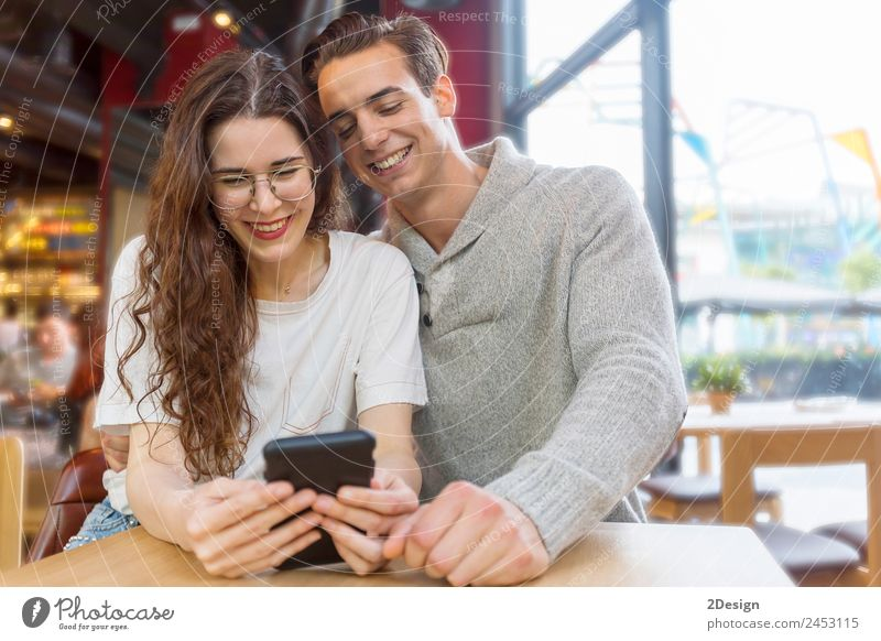 Funny couple or marriage sharing a smart phone Woman Human being Youth (Young adults) Man Young woman Young man House (Residential Structure) Joy 18 - 30 years