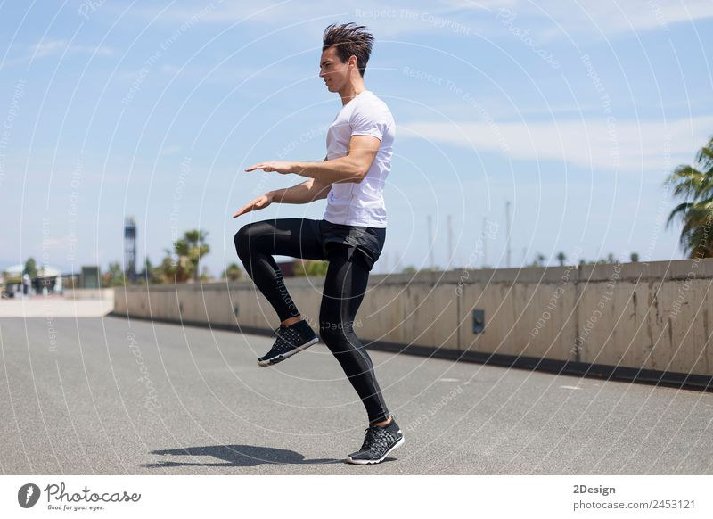 Happy man and jumping outdoors, warmup before jogging Woman Human being Youth (Young adults) Man Young man 18 - 30 years Adults Lifestyle Sports Movement