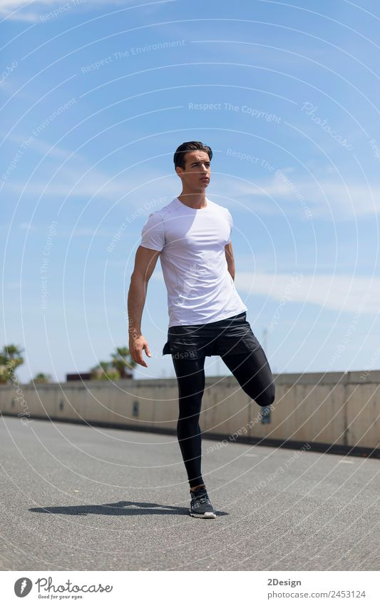 Young man stretching in the city after jogging Human being Youth (Young adults) Man Summer 18 - 30 years Adults Lifestyle Sports Bright Masculine Body Action