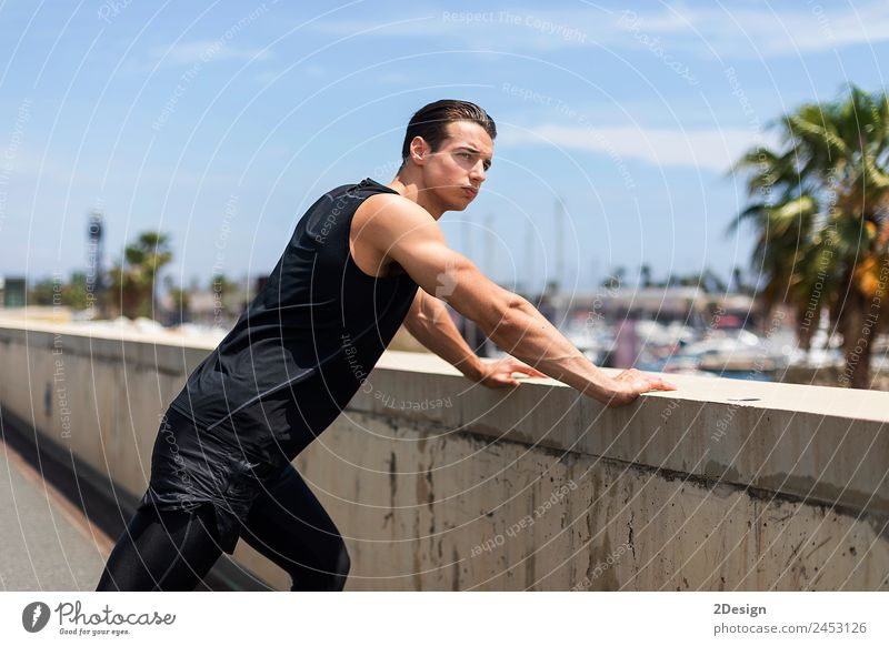 Strong Man Stretching Calf and Leaning on Wall Lifestyle Body Health care Wellness Summer Sports Human being Masculine Young man Youth (Young adults) Adults 1