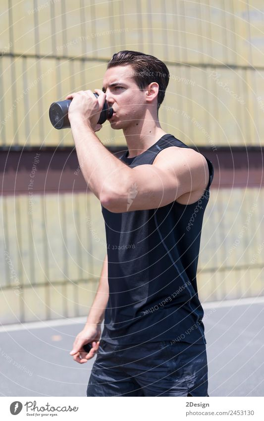 Young sportsman drinking water after jogging Drinking Bottle Lifestyle Summer Sports Jogging Human being Masculine Young man Youth (Young adults) Man Adults 1