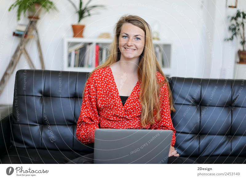 Entrepreneur woman wearing red shirt working with a laptop sitting on a couch at home Shopping Happy Beautiful House (Residential Structure) Sofa School Study