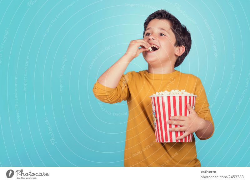 happy boy with popcorn Food Lifestyle Joy Leisure and hobbies Human being Masculine Child Toddler Boy (child) Infancy 1 8 - 13 years Theatre Cinema