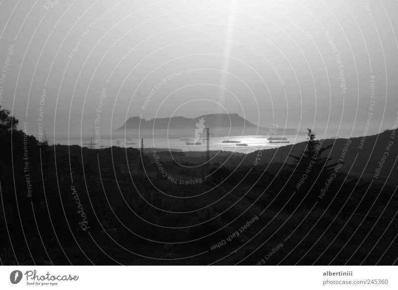 the strait of gibraltar Environment Water Street Navigation Container ship Oil tanker Watercraft Driving Black & white photo Exterior shot Experimental Deserted