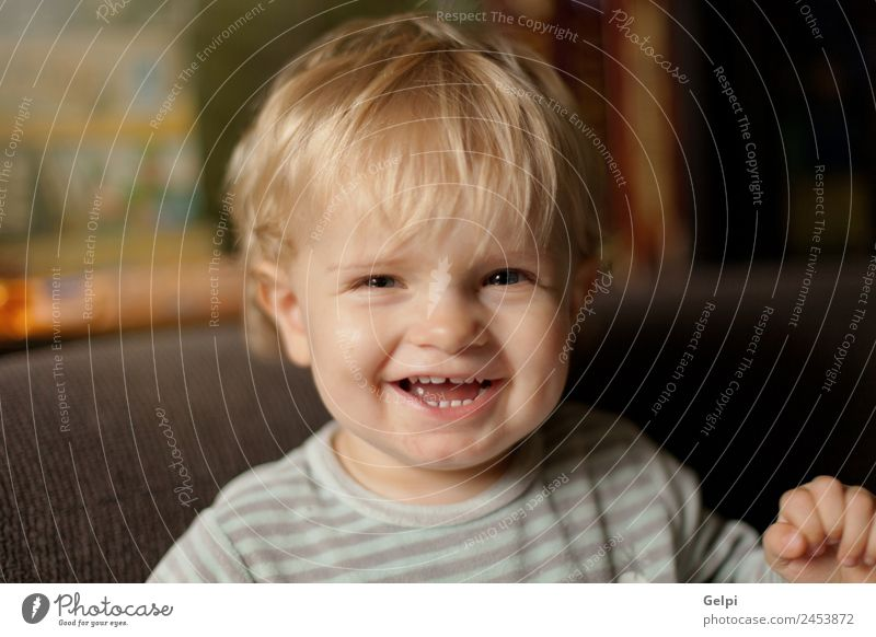 Adorable baby with one year old Joy Happy Beautiful Life Playing Living room Child Baby Toddler Boy (child) Family & Relations Infancy Mouth Blonde Smiling